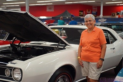 Linda standing by a white 1967 Chevy Camero.  It was similar to the one she owned except that hers was a convertible and had a red interior.  Muscle Car Museum, Punta Gorda, FL.