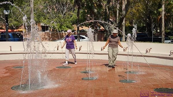 Mara and Linda play in the fountain in Venice, FL.