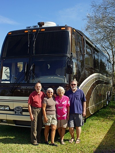 Me, Linda, Mara, and Michael in front of our Prevost H3-40 at Big Tree Carefree RV Resort, Arcadia, FL.